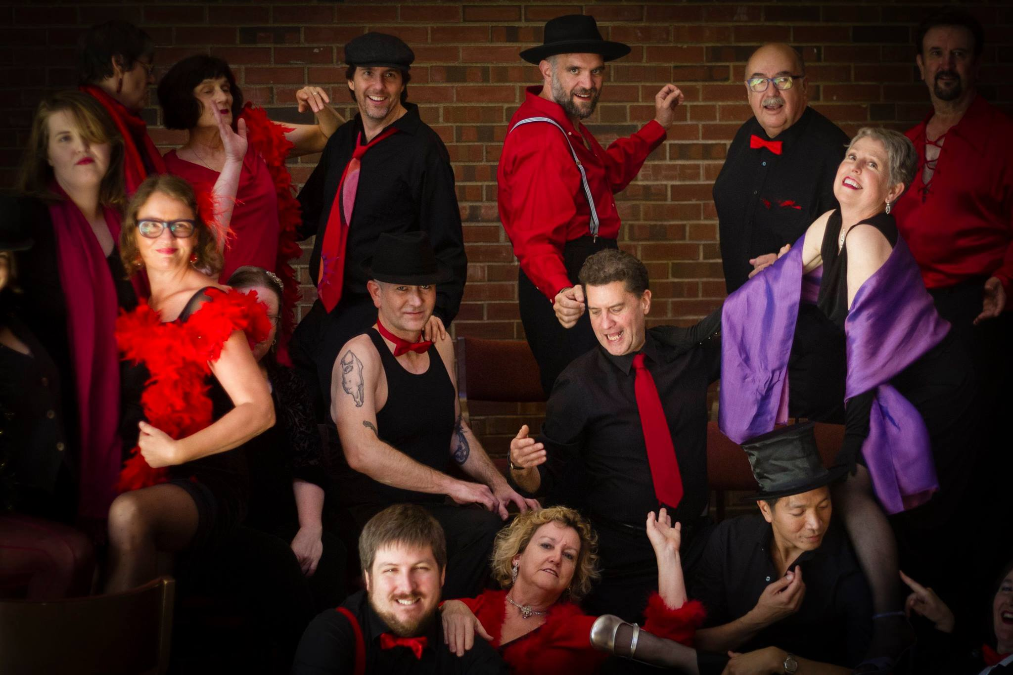 "Northwest Firelight Chorale. Promo photo from the ""Too Darn Hot!"" fundraiser performance in 2015 (credit Dartanyon Race)"